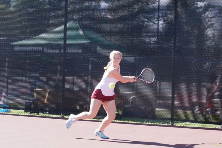 Ponderosa senior Claire Cox prepares to make a backhand return during the No. 2 singles championship match during the final day of the Class 5A state girls tennis tournament. Cox won the match in three sets and Ponderosa finished third in the team standings.