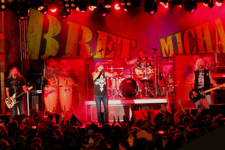 "The Bret Michaels band rocks the Parker Days stage in the parking lot at O'Brien park on June 8. Michaels displayed an abundance of energy, jumping around the stage and engaging the crowd between and during hits like ""Every Rose Has Its Thorn."""