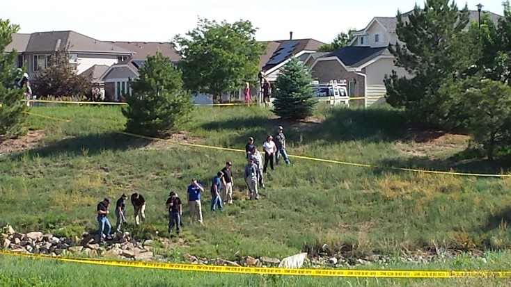 "Police search the area around 128th and Jasmine Friday morning June 9, the site where the body of 10-year-old Kiaya Campbell was found June 8. The Adams and Broomfield Counties Coroner confirmed the body belonged to Campbell and ruled the cause of death as ""other than accidental."""