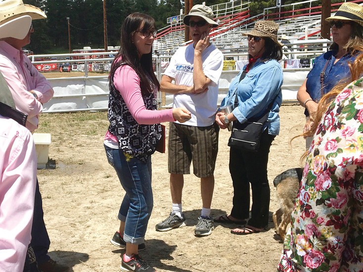 Behind-the-Chutes tour director Caylee Burns in action at the Elizabeth Stampede June 3.