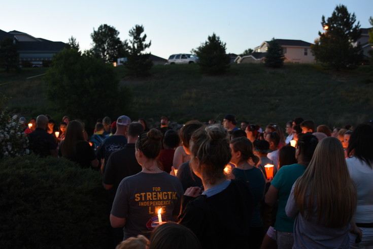 Thornton area residents turn out for a Saturday candlelight vigil in memory of 10 year-old Kiaya Campbell, whose body was found near this spot along E. 128th Avenue and nearby Jasmine Court last Thursday. Thornton Police estimated the crowd at 350.