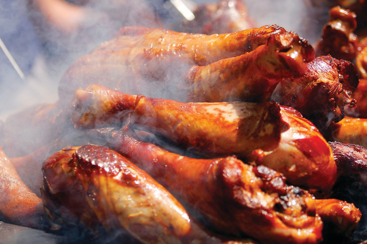 A heap of smoking turkey legs sizzle as they await hungry patrons, who had their choice of carnival food, local vendors and food trucks from the metro area to provide fuel for the weekend's festivities.