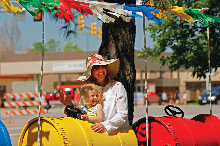 Jennifer Huffman and her 2-year-old daughter, Isabella, take a loop on the miniature train in O'Brien Park on June 10 at the Parker Days festival. The Huffmans came from Aurora so Isabella could ride the  train and ponies at the park.