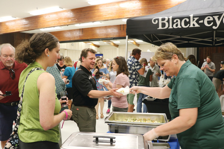 Hungry Jeffco residents sample fish tacos from Rubio's at the annual Taste of the West event on June 8.