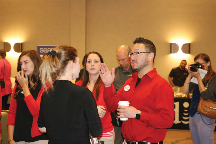 Target employees answer questions about job opportunities with the company during a job fair for Colorado Mills employees on June 7.