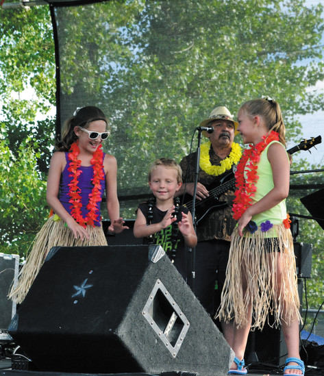 During the 2016 luau, Parker residents, from left, Addison, Carpenter and Allix Rousch were asked to join Polynesian Fia Fia on stage to hula dance.
