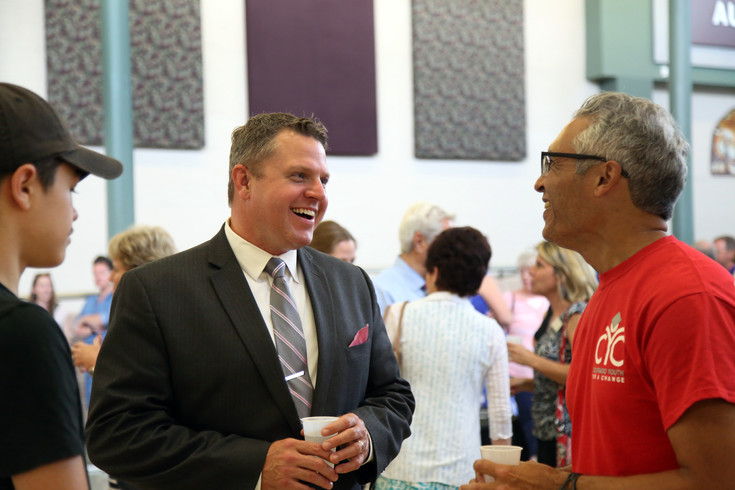 New Jefferson County Schools Superintendent Dr. Jason Glass talks with community members June 8 at Lakewood High School during a community welcome event.