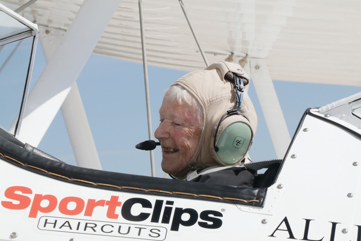 Billie McMahon, 91, smiles as a 1940s Boeing Stearman biplane taxis out to the Centennial Airport runway to take her on an aerial spin of the area. McMahon, a World War II veteran and MorningStar of Littleton resident, was one of about a half-dozen veterans who were passengers aboard the Stearman 0n June 7. The Ageless Aviation Dreams Foundation provided the flights for free.