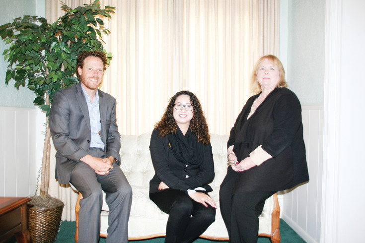From left, Damon Henry, Olinger Woods Chapel's general manager; Melinda Acevedo, funeral director; and Judy Jacobs, office manager, sit in the lobby of Olinger Woods Chapel, which is located at 1100 Washington Ave. in historic downtown Golden. On June 30, the funeral home will merge its services with Olinger Crown Hill Mortuary & Cemetery, 7777 W. 29th Ave., in Wheat Ridge.