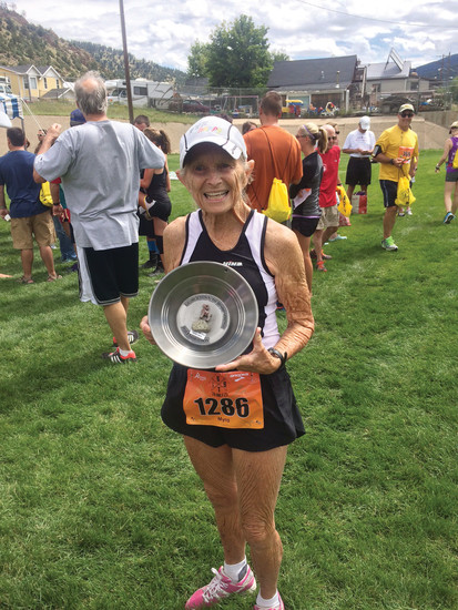 Myra Rhodes holds the trophy from winning her 70-99 age group at the Georgetown to Idaho Springs Half Marathon in August 2015. Rhodes is an inspiration to her family and her community as she competes, and wins, distance races at the age of 85.