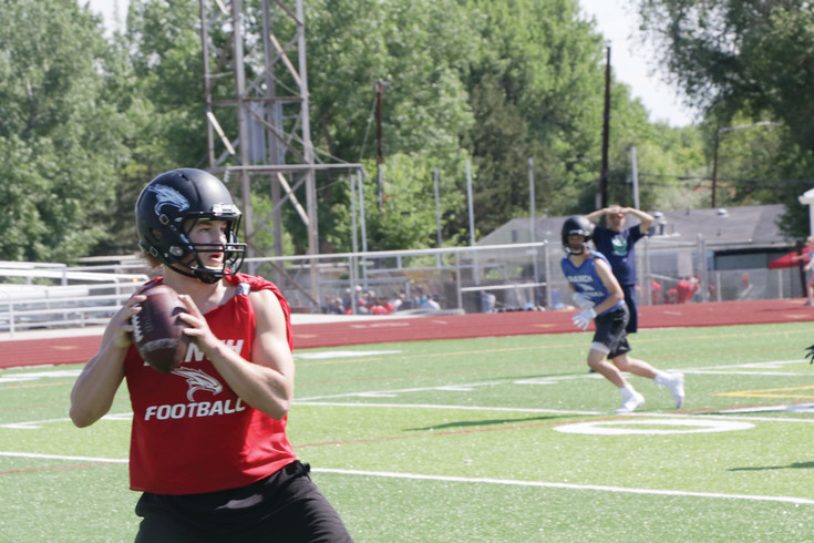 Highlands Ranch quarterback Joe Albert looks for a receiver during the June 2 game against George Washington at the Englewood High School Stadium during the Pirates' 7-on-7 football tournament. Albert completed this pass and the Falcons went on to finish fifth in the tournament.