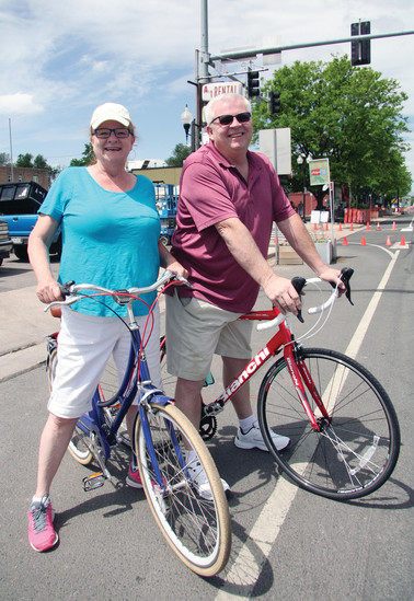 "Diane Robb and Rich Doughtery rode their bikes a few blocks from their homes, down to the criterium on June 11.  ""It's just an exciting community day, and a great family event,"" said Robb. ""We're siblings."""