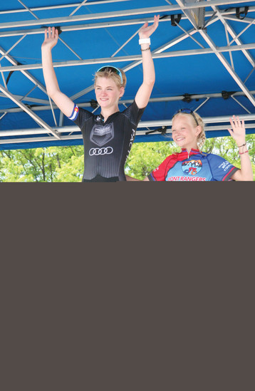 First place winner Cassidy Hickey, and second place finisher Amoris Bigler-Redd stand on the awards podium at the June 11 Ridge at 38 Criterium, representing the junior women's 12-14 year old category.