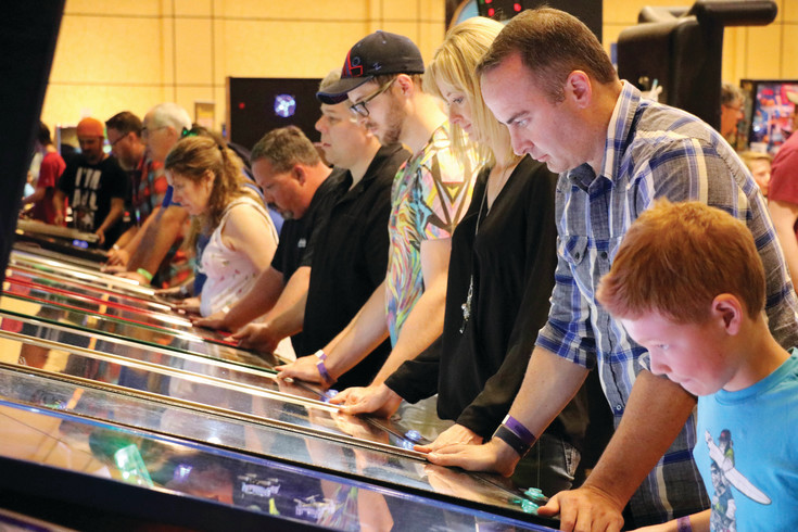 Dozens of people fill a hotel conference room on June 9 for the 17th annual Pinball Showdown and Gameroom Expo. The weekend-long event featured hundreds of vintage pinball machines and arcade games.