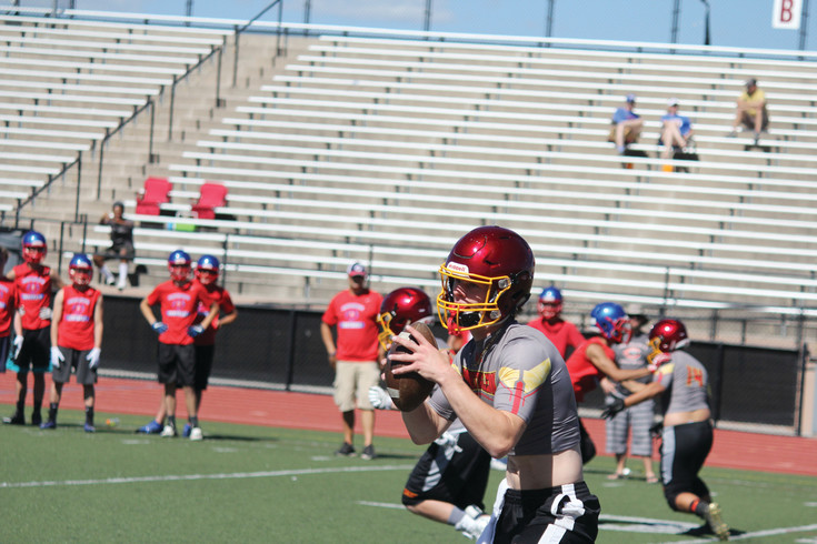 Northglenn quarterback Devin Scudder looks for a receiver during the game against Centaurus during the June 14 competition at the Broncos 7-on-7  tournament at Denver All City Stadium. Scutter completed the pass but Centaurus won the game in the second overtime.