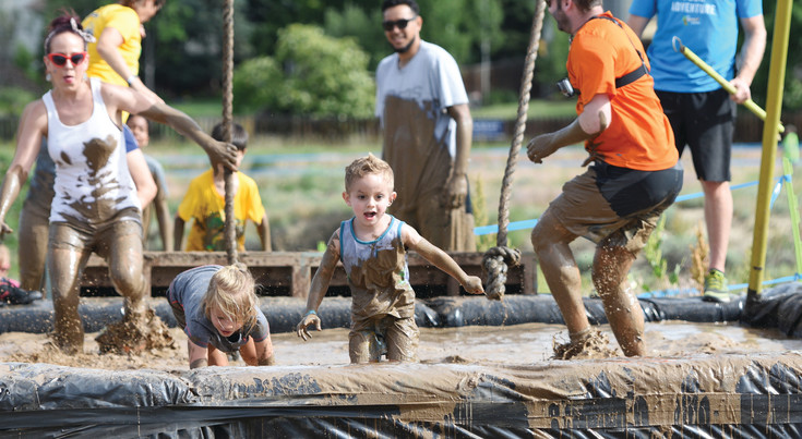 "Parents and kids from across the Front Range converged on Westminster's City Park June 17 for the Kids Obstacle Challenge Denver. ""It's all about the mud,"" event director Kyler Hannon said."