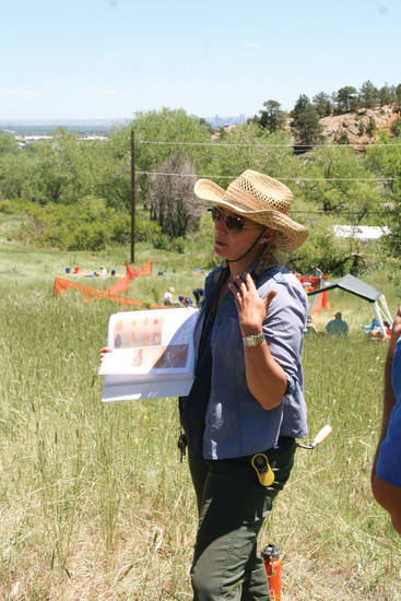 Dr. Michele Koons, curator of archaeology at the Denver Museum of Nature & Science, introduces participants at a community archaeological dig on June 14 to the archaeology work that has been done at Magic Mountain.