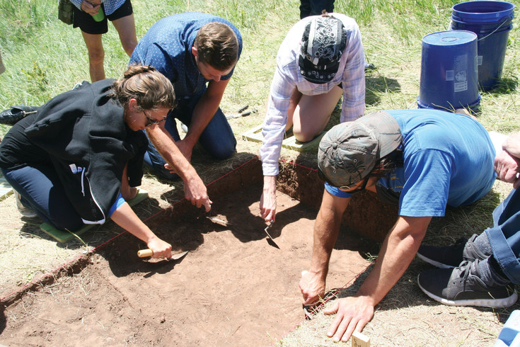 Community members, from left, Lindsay Hislop, Nate Tipple, Jolene Cox and Eric Hislop dig for artifacts on June 14 at Magic Mountain. Lindsay Hislop signed up her friends and family to participate in the community dig, which was put on by the Denver Museum of Nature & Science.
