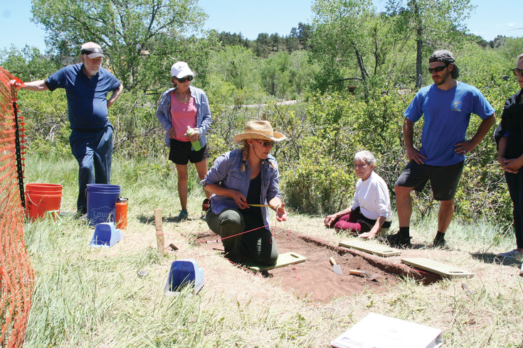 Dr. Michele Koons, curator of archaeology at the Denver Museum of Nature & Science, teaches participants how to measure a plot and what tools to use during a community archeological dig at Magic Mountain on June 14.