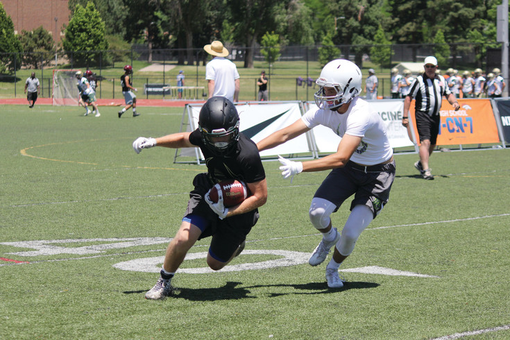 Colton Whiteside gains yardage for Mountain Vista after catching a pass during the June 15 Broncos 7-on-7 tournament played at Denver All City Stadium. The Golden Eagles played three games June 15.
