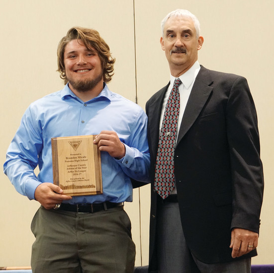 Pomona High School's three-sport athlete graduate Brandon Micale, left, stands with Mike Santarelli, Pomona athletic director, after being named the Class 5A Jeffco Male Athlete of the Year.