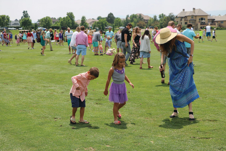 In between practice games, families and young children flood the polo field to stomp the divots, which are torn up by ponies. Guests were at the field, 4400 W. Mineral Ave., Littleton, on June 24 for Denver Polo Classic Family Day.