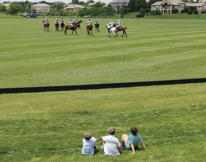 Young spectators watch as polo players on their ponies stride along the pristine field, located at 4400 W. Mineral Ave., Littleton. The June 24 Family Day was one of three Denver Polo Classic events.