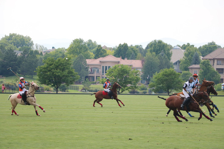 Polo players practice their skills for a crowd of all ages at the Denver Polo Classic Family Day on June 24 at Polo Reserve, 4400 W. Mineral Ave. The weekend-long event is the nation's largest charitable polo tournament.