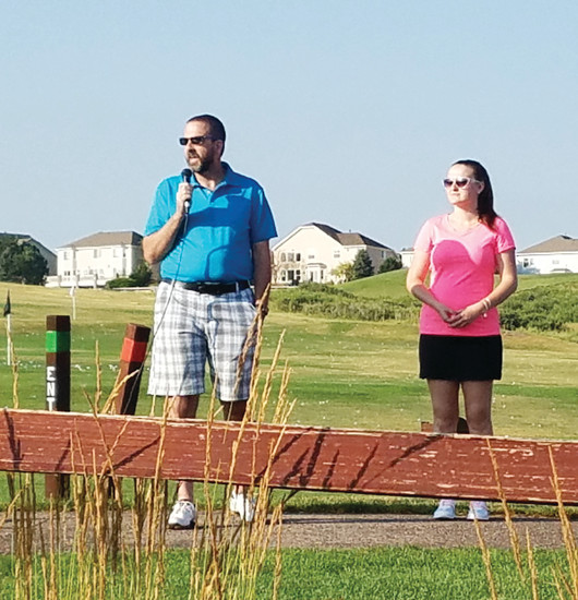 Scott Jackson, left and Mallory Pridemore address the golfers at the 2016 fundraising tournament for the Debbie Jackson Memorial Foundation. After last year's event, Jackson and Pridemore's uncles, Al, Dwight and Vince, decided the Pridemores should joined the board for the foundation to increase the group's impact.