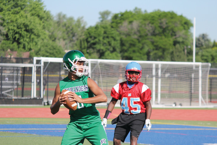 Quarterback Diontaye Wallace looks to complete a pass for Kennedy during the June 14 the Broncos 7-on-7 tournament pool play game against Manuel played at Denver All City Stadium.  The Commanders won all three pool play games and  earned a spot in the June 17 championship single-elimination tournament played at the Broncos Training Facility. Kennedy  lost in tournament play to Denver East.