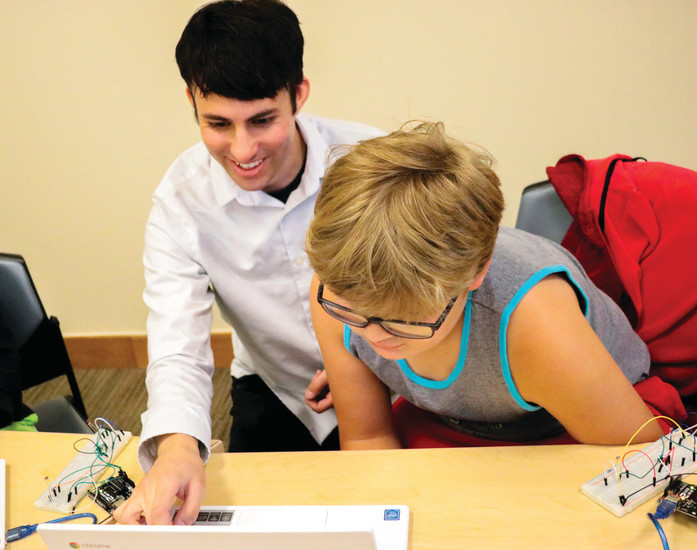 Instructor and camp leader Rudy Klucik shows Zack Wolfinger how to de-bug code that isn't working as it should during a University of Colorado South Denver Coding with Kids camp on June 23.