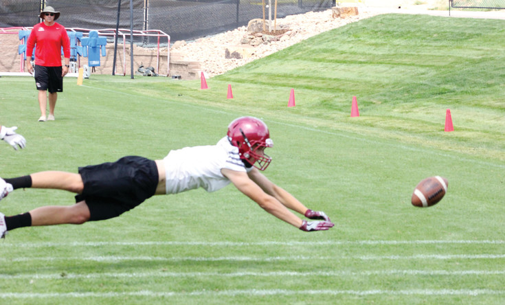 Ponderosa wide receiver Kade Ongna stretches out in an attempt to catch a pass on June 17 during the Denver Broncos' 7-on-7 tournament.  The Mustangs advanced to the quarterfinals June 17 at the UCHealth Training Center in Centennial before being eliminated.