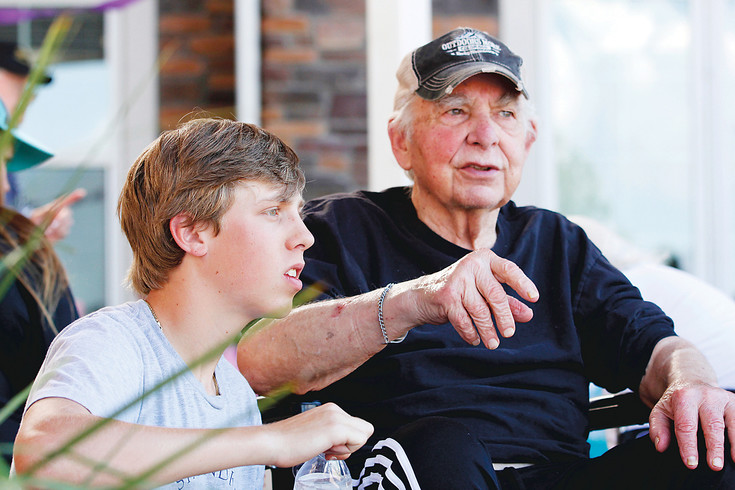"Jackson Fite, left, and Chelsea Place resident Al Coco share a conversation during ""The Longest Day,"" a fundraiser hosted by Avantara Crown Point rehabilitation facility in Parker. Fite, 16, and 10 other volunteers came from Denton, Texas, to assist in the event. ""He's a perfectly good teenager,"" Coco said."