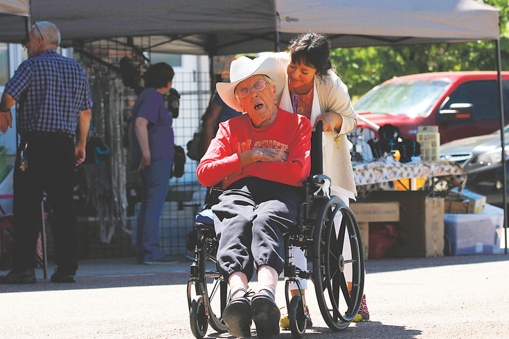 Wallace Johnson, a patient at Avantara Crown Point, takes a lap with activities director Rebecca Brown during the rehabilitation facility's fundraiser for the American Alzheimer's Association. More than 30 clients form Avantara and Aurora's Chelsea Place memory care participated in the sponsored walk and bake sale.