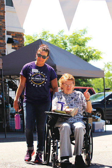 Dr. Candace Fernandez, clinical manager of rehabilitation at Avantara Crown Point, and patient Estella Shipley round the corner for the sponsored walk benefiting the American Alzheimer's Association on June 21. The Fundraiser beat Fernandez's goal of $800, totaling nearly $1,000.