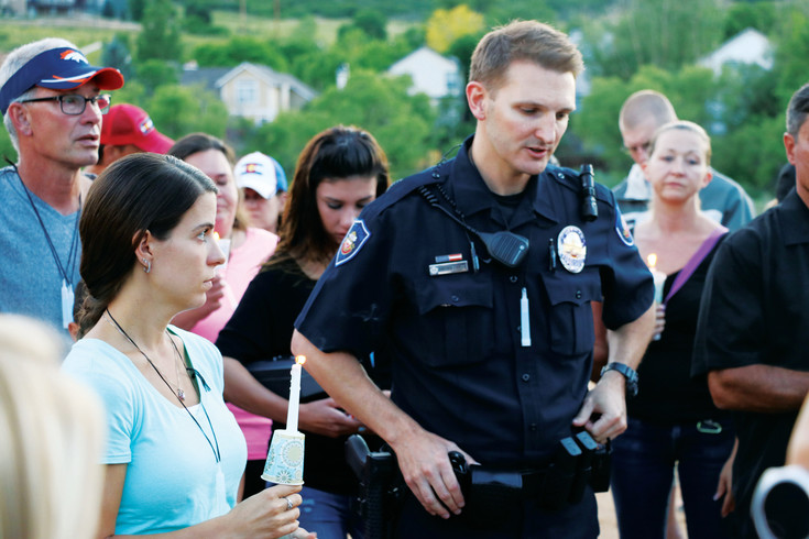 Olivia Beare, left, stands next to Christopher Mannerings, a Littleton police officer who attended police academy with Steven Beare, an officer who two weeks ago went missing while hiking in Russia. The June 29 vigil was held at Roxborough Park, 7673 N. Rampart Range Road.