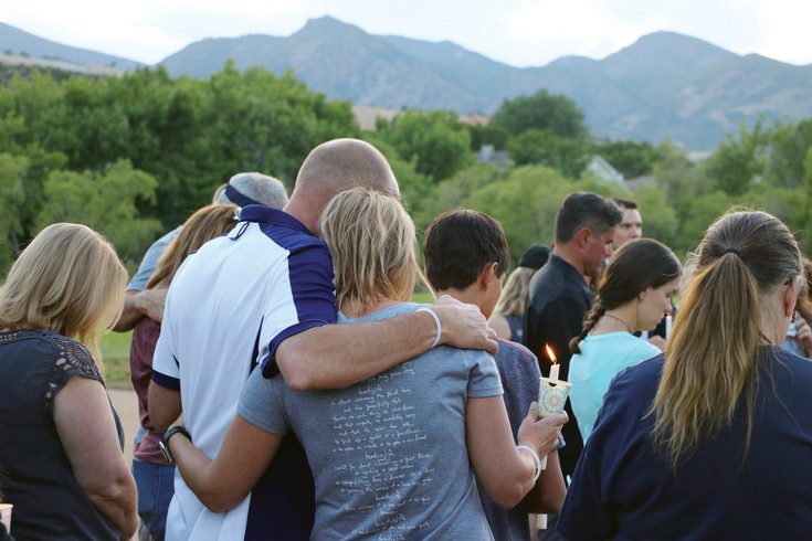 Guests of a June 29 vigil held at Roxborough Park, 7673 N. Rampart Range Road, pray for the return of Steven Beare, a Littleton police officer who went missing while hiking in Russia.