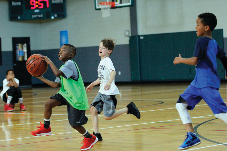 Young players at the Chauncey Billups Basketball Academy scrimmage at the Parker Fieldhouse on June 27. Players were divided by age and skill level at the camp, working on defensive play, speed, agility and sportsmanship in addition to scoring and passing.