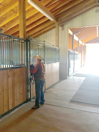 Suzy MacKenzie tends to the stables of Eagle's Nest Ranch which are provided by Life Centre Ministries.