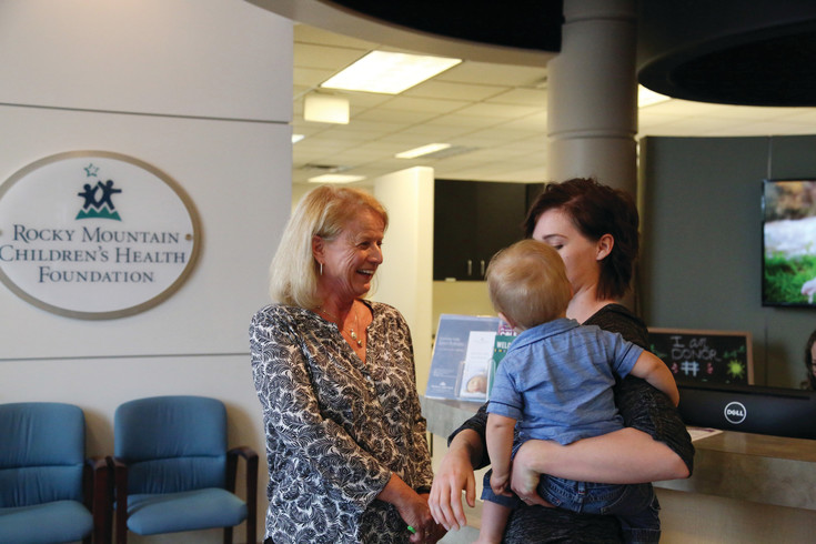 Laraine Lockhart Borman, director of outreach Mothers Milk Bank, reconnects with Kelsey Danker one year after bringing her milk donations at the hospital.