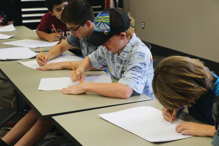 Children get practice writing and developing comics thanks to an event hosted by Pop Culture Classroom at the Golden Library on June 21.