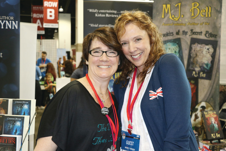 Fantasy authors Corinne O'Flynn, from Parker, left, and Wendy Terrien, from Highlands Ranch, at their stands in Author Alley at Denver Comic Con. Authors are always a big draw to the con, because it gives readers the opportunity to get an autograph, and chat with their favorite writers.