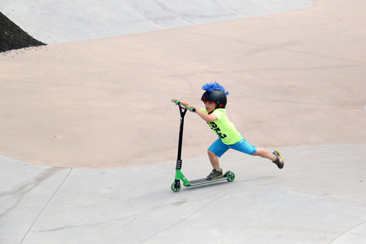 Arvada resident Carson Lang, 4, rides his scooter at the Arvada Skate Park.