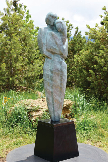 "Roxborough has joined Art Encounters this year, with five pieces. Shown: ""Tenderness,"" two figures carved from stone by Reno Carollo. It is located at 9635 N. Rampart Range Rd."