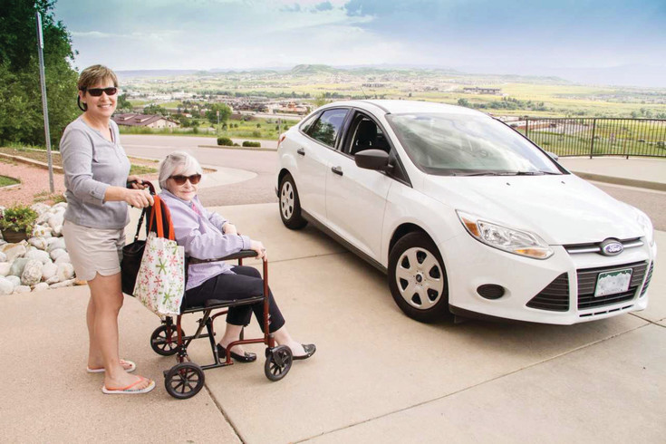 Deb Goldberg offers a ride to Mary Rotenberry through the transportation services offered by Neighbor Network in Douglas County.