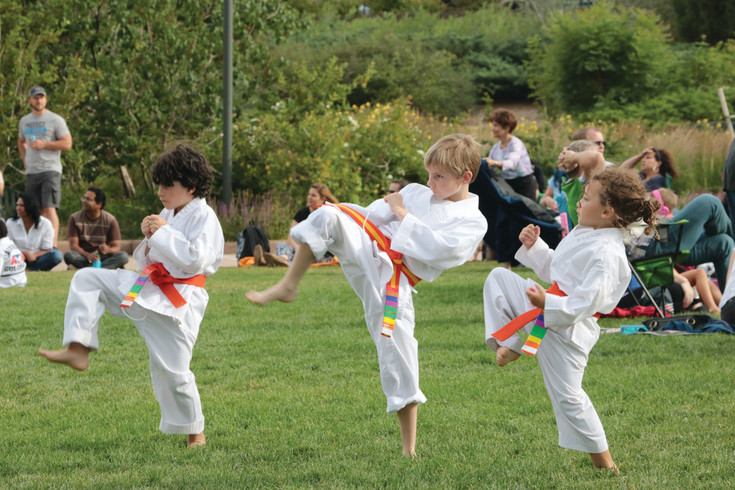 Students of ATA Karate Denver, a martial arts school with Littleton and Lone Tree locations, meet at Civic Green Park, 9370 S. Ridgeline Blvd., on June 29 to test for belts. The evening involved a series of drills to test martial arts practices and endurance.