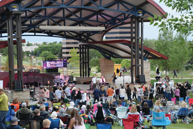 The City of Centennial and the Arapahoe Library District co-hosted the summer's first Music & Movie Night on June 24. Though the winds were too strong to play the movie, people still danced to local 1980s cover band the 6 Million Dollar Band.