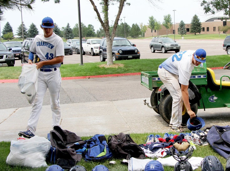 Grandview High School players Luke LaFlam, left, and Hayden Isenhart add items to the growing collection of used baseball equipment destined to be delivered to schools in Nicaragua that receive no money for sports program.