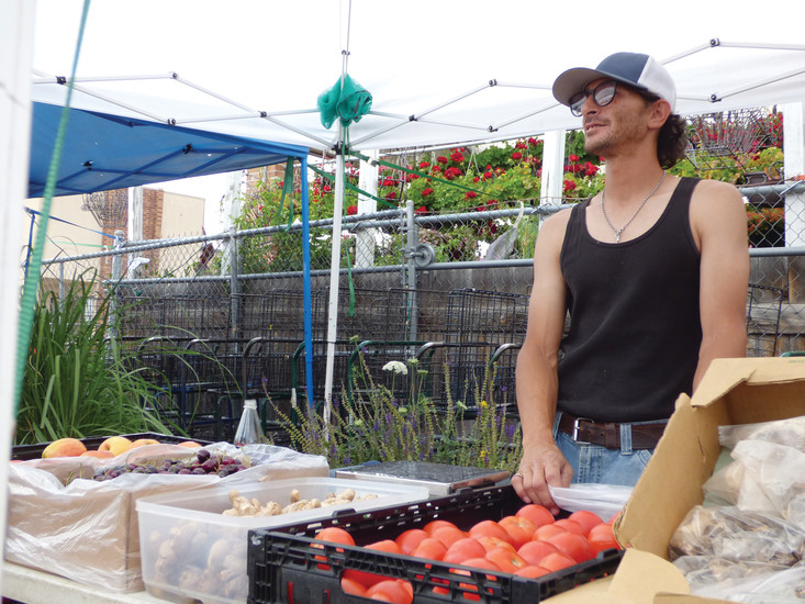 Diego Hernandez reigns over his kingdom of fruits at the O'Toole's Farmers Market.
