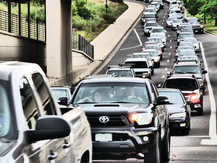 Friday rush hour traffic backs up on the westbound lanes of Mineral Avenue at Santa Fe Drive on July 7. Littleton city officials are working to alleviate congestion issues along the Santa Fe corridor, but the process is likely to take years.